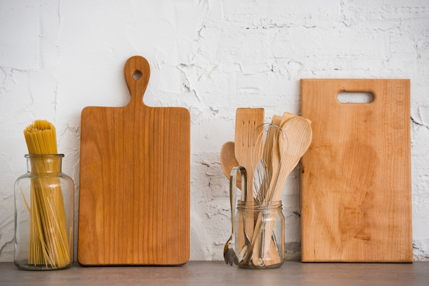 Wooden utensils on the countertop Free Photo
