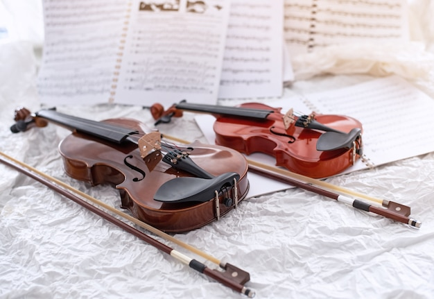 The wooden violin and bow Premium Photo