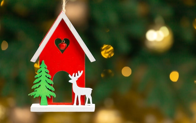 Wooden xmas toy. house with deer. Premium Photo