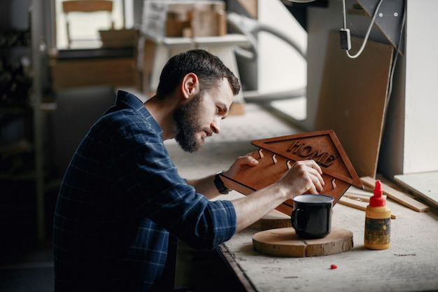 Woodworker applying glue to coards Free Photo