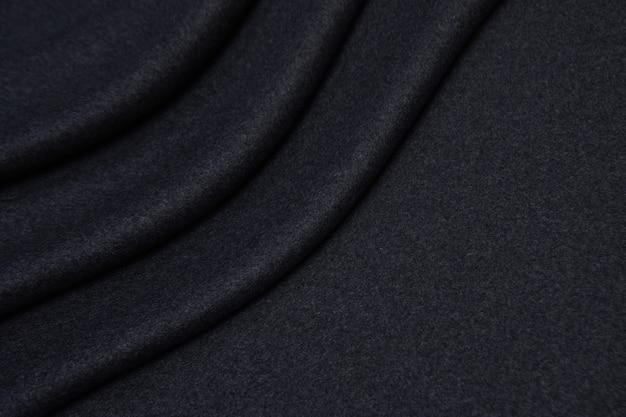 Шерстяная ткань в серой текстуры крупным планом Premium Фотографии