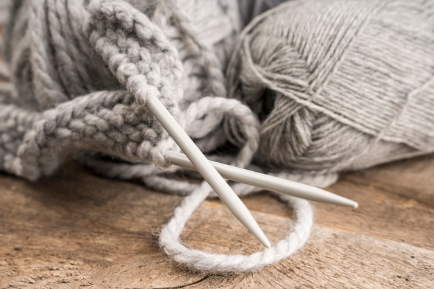 Wool and plastic crocheting needles Free Photo