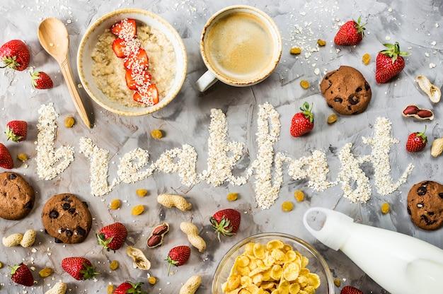 The word breakfast is written d of oatmeal Premium Photo