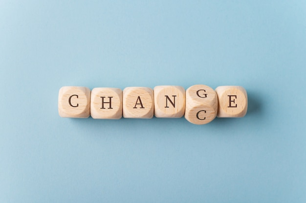 Word change changing in to chance spelled on wooden dices Premium Photo