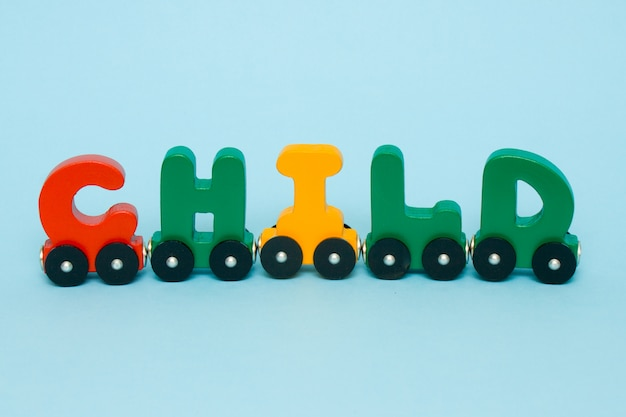 Word child made of letters train alphabet. Premium Photo