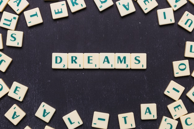 Word dreams in scrabble letters from above Free Photo