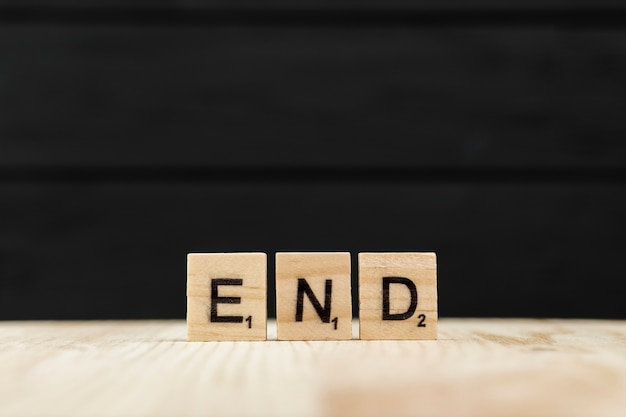 The word end spelt with wooden letters Premium Photo