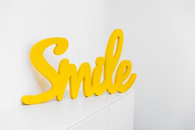 Word figure on cupboard Free Photo