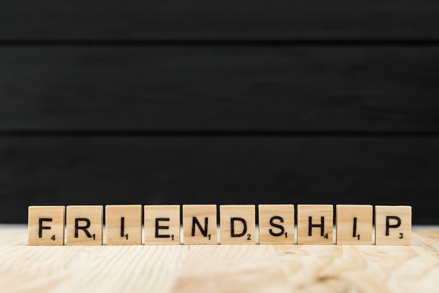 The word friendship spelt with wooden letters Free Photo