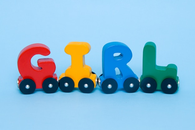 Word girl made of letters train alphabet. Premium Photo