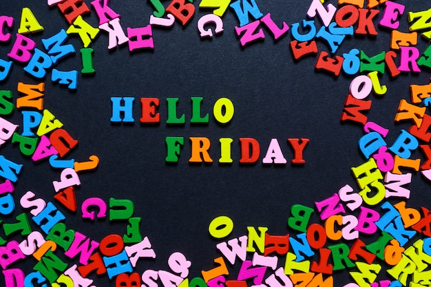 The word hello friday from multi-colored wooden letters on a black background Premium Photo