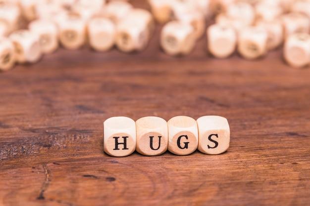 Word hugs written on wooden blocks Free Photo