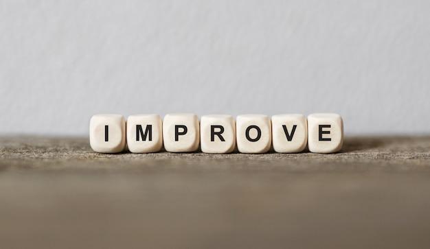 Word improveは、木製のビルディングブロック、ストックイメージで作られました Premium写真