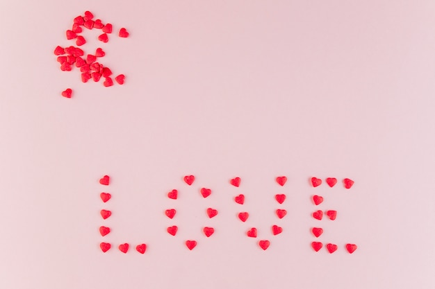 Word love made of decorative hearts Free Photo