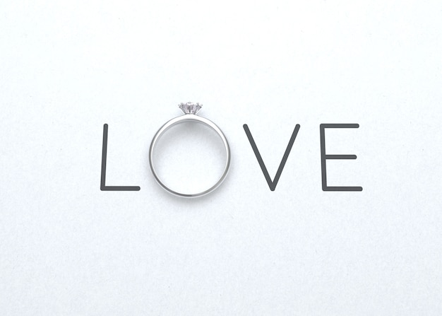 The word love with wedding ring on white paper for valentines day background 3d rendering Premium Photo