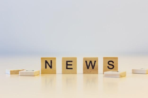 The word news on cubes Premium Photo
