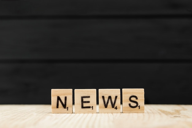The word news spelt with wooden letters Premium Photo