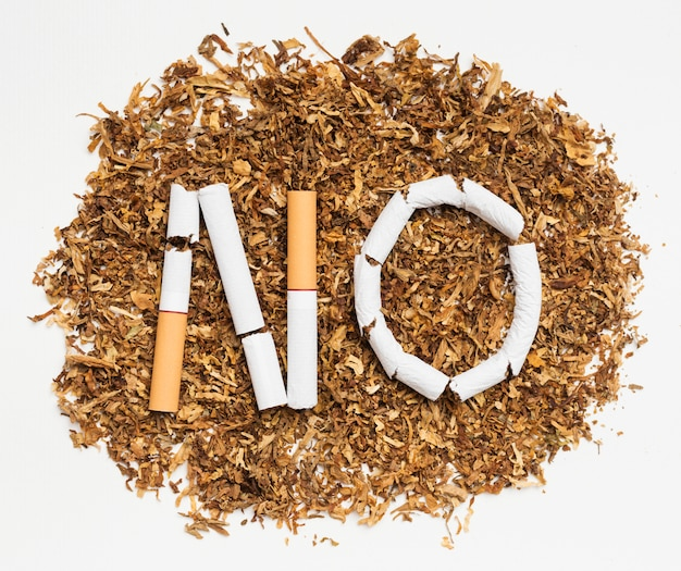 Word no made from broken cigarette over tobacco Free Photo