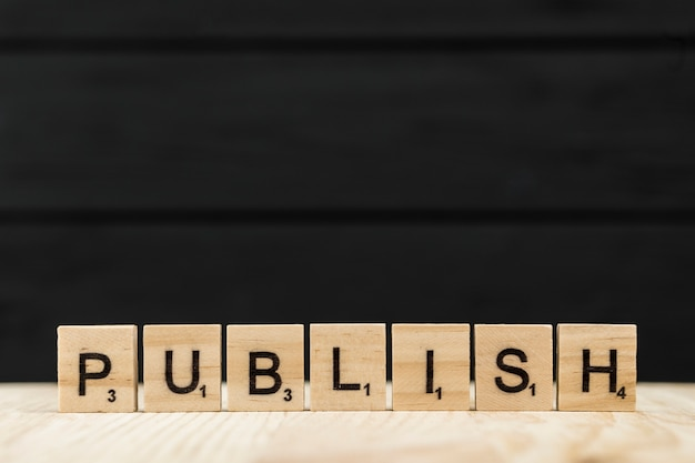 The word publish spelt with wooden letters Free Photo