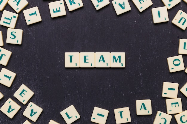 Word team in scrabble letters over black backdrop Free Photo