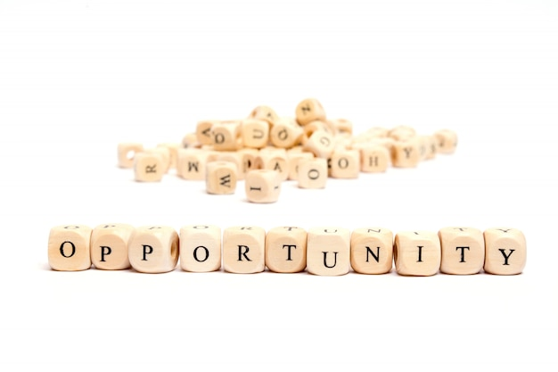 Word with dice on white background- opportunity Premium Photo