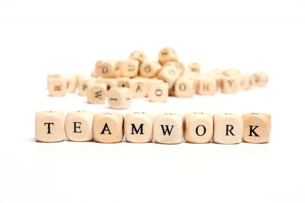 Word with dice on white background- teamwork Premium Photo