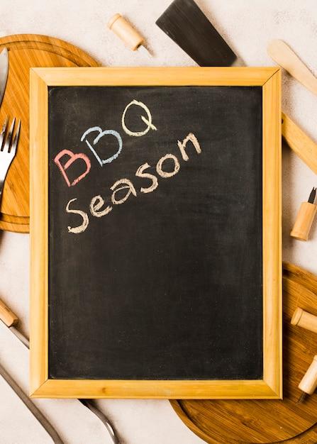 Words bbq season on blackboard Free Photo