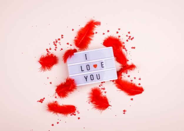 Words i love you on the light box on a light background. place for text, abstract content. Premium Photo