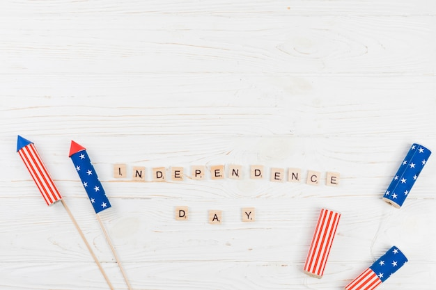 Words independence day with firecrackers Free Photo