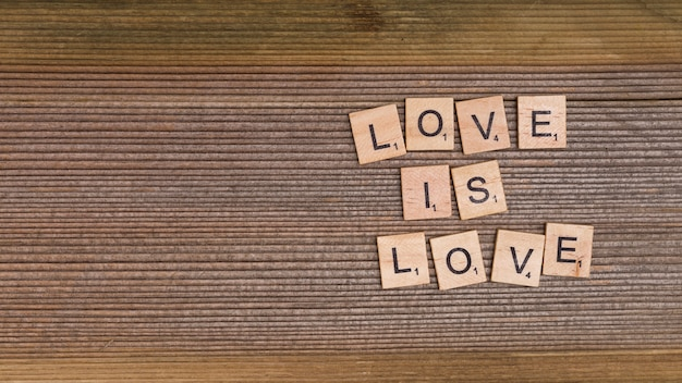 Words love is love from wooden elements Free Photo