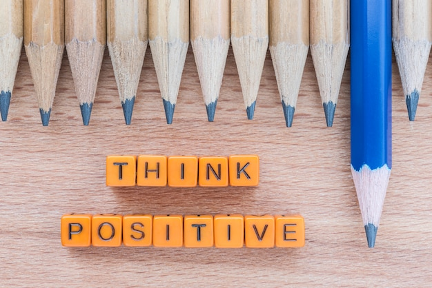 Words think positive on wooden table with group of pencils. Free Photo