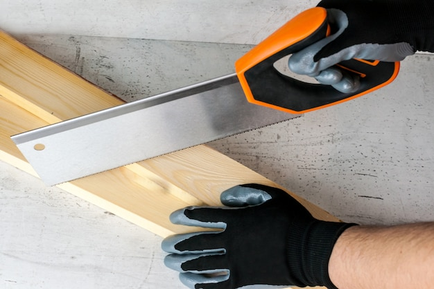 Work on the construction or repair of the house. independent update, renovation. use saw, work gloves. Premium Photo