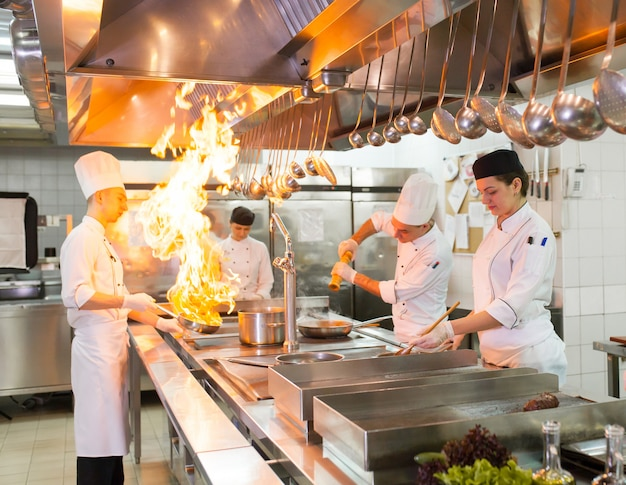 The work of the cook in the kitchen of the restaurant. Premium Photo