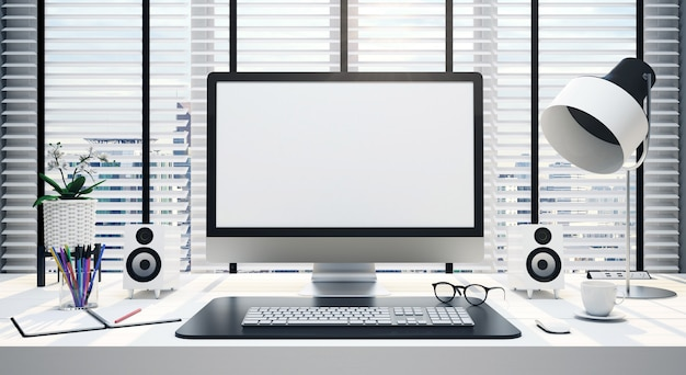 Work desk with blank computer screen in an office Premium Photo