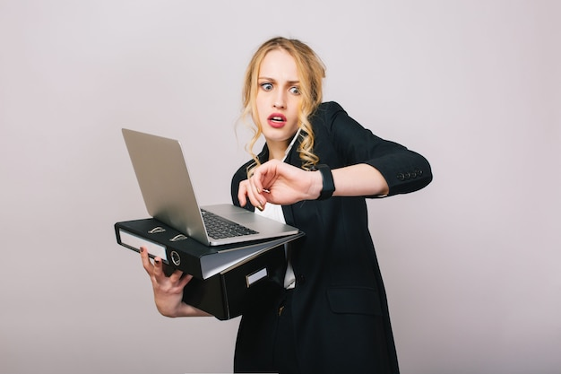 Work office busy time of blonde young woman in formal clothes with laptop, folder talking on phone. astonished, working, profession, secretary, office worker, manager Free Photo