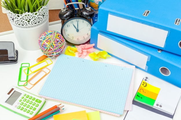Work place of a creative person with a variety of colorful stationery objects Premium Photo