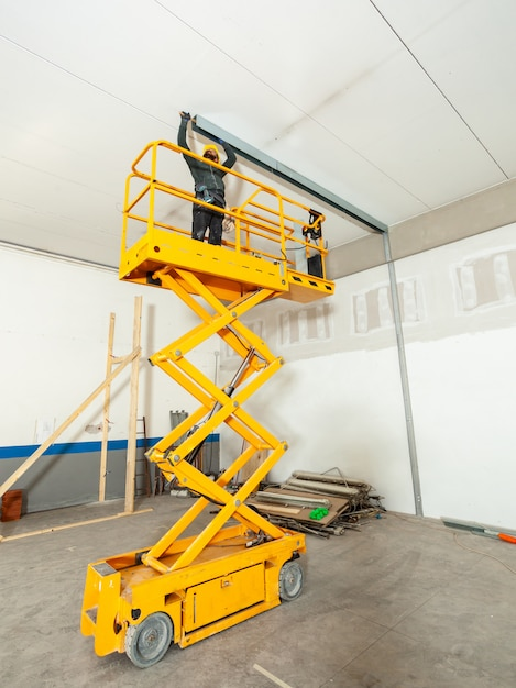 Worker builds a plasterboard wall. Premium Photo