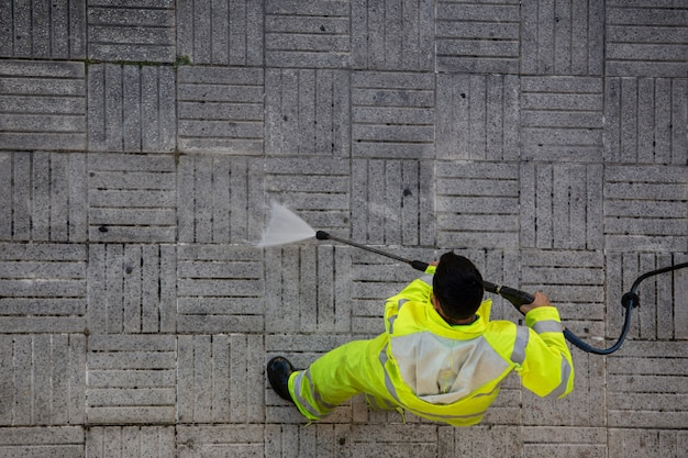 Worker cleaning the street