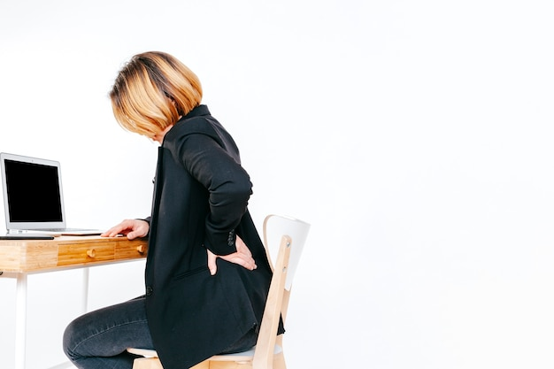 Worker of office having back ache Free Photo