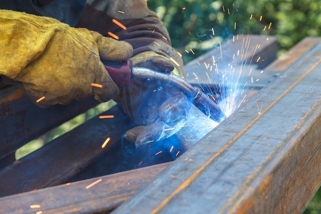 Worker welding in a factory. welding on an industrial plant. Premium Photo