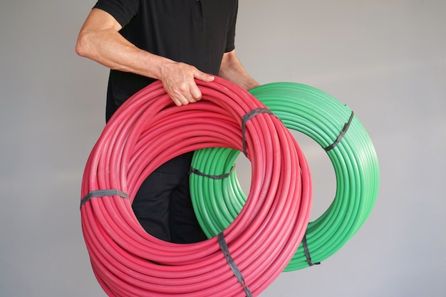 Worker with electrical protective tube Premium Photo