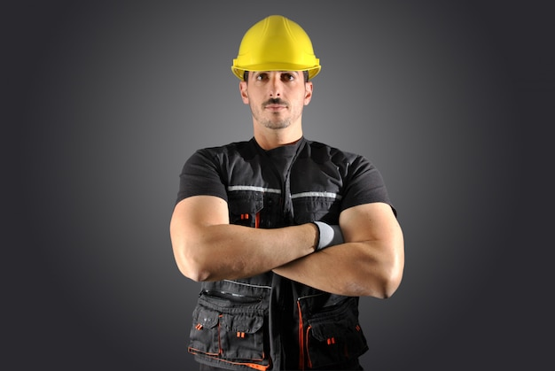Worker with yellow helmet and face crazy Premium Photo