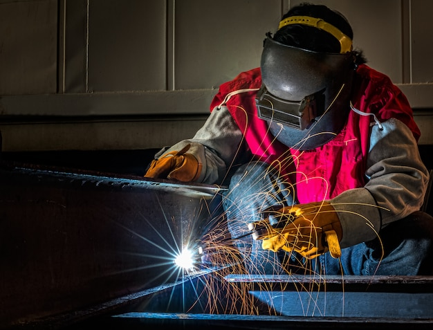 Premium Photo Worker Works Hard With Welding Process