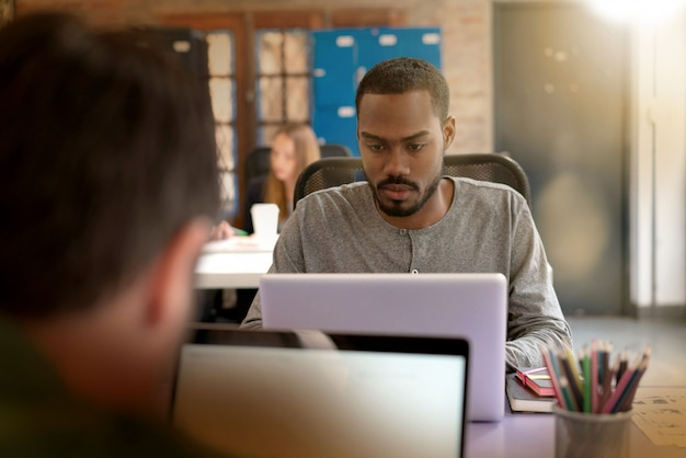 Workers busy working in modern office space Premium Photo