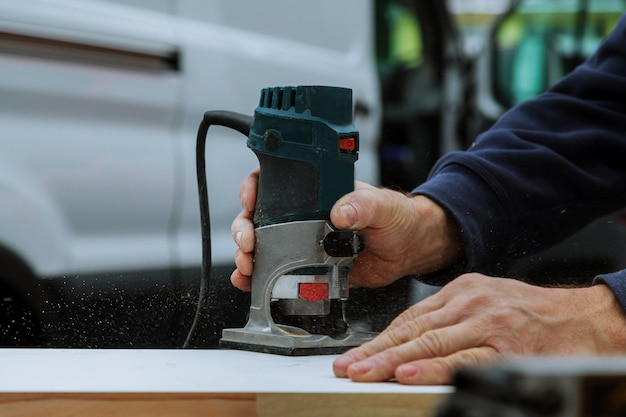 Workers using electric routering to cut down stripes Premium Photo
