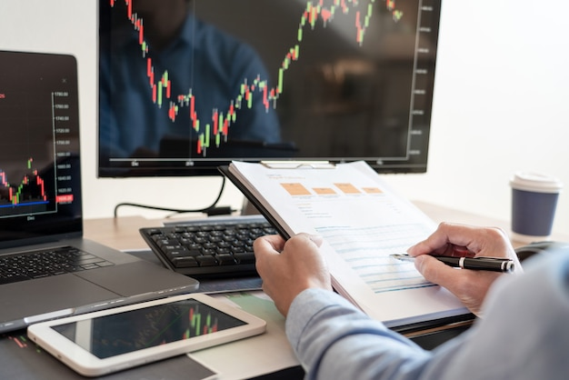 Premium Photo | Working business man, team of broker or traders talking  about forex on multiple computer screens