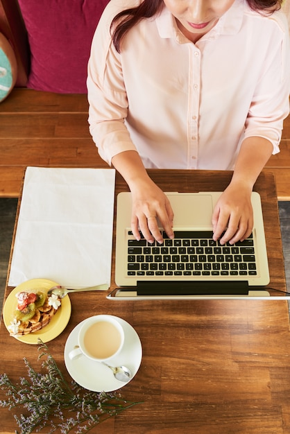Working in cafe Free Photo