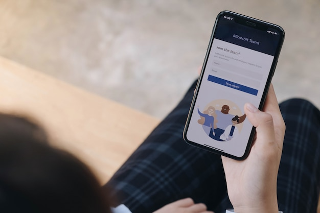A working from home employee is downloading social platform, ready for remote working in isolation from home Premium Photo