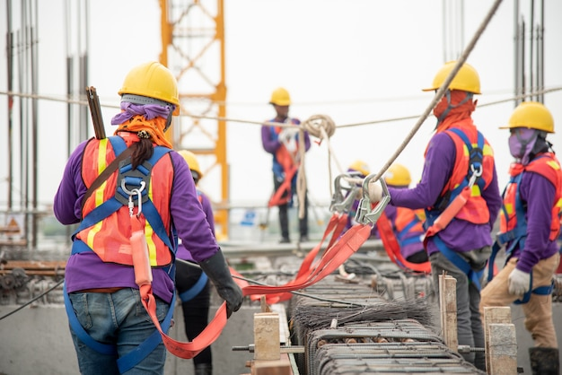Working at height equipment. fall arrestor device for worker with hooks for safety body harness Premium Photo