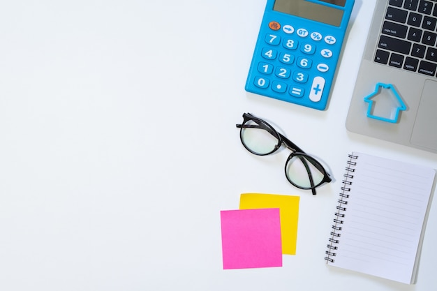 Working space and office supplies on white Premium Photo